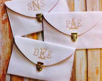 7 Monogrammed Leather Envelope Clutches