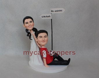 wedding cake toppers dragging groom