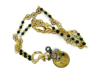 OOAK Steampunk Necklace with Egyptian Coin, Watch Gears, and Emerald Green Swarovski Crystals