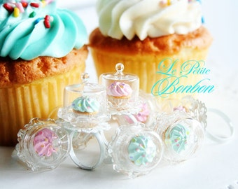 Birthday cupcake on a cake dome ring