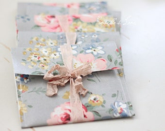 5 oilcloth sleeves, CD sleeves in pink floral oilcloth sleeves