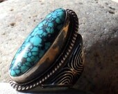 OFF THE BENCH . spirit of the west . kingman turquoise . sterling silver . ring