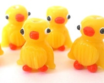 3 yellow duck beads, lampwork glass, orange markings