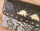 Gold rock stegosaurus bag. Black patent leather and stamp reptil fabric with stud