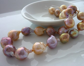 Outstanding metallic nucleated baroque drop lilac peach pearls 16-22mm