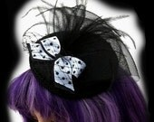 Retro Inspired Hat Fascinator with Polka Dot Bow Black and White with Feathers Net Embellishment