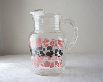 mid century glass pitcher - large pink and black atomic dots - 1950s - 1960s - ice catcher