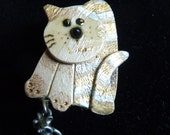 Precious ceramic pin brooch of cat and mouse signed P. Heck