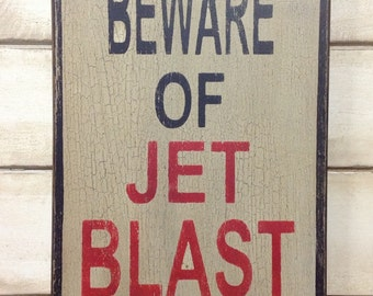 Beware of jet blast sign made from reclaimed plywood