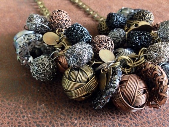 Metal to the max! Mixture of woven metal beads, plates and chain.
