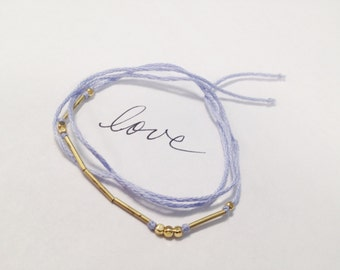 With Love wish bracelet in periwinkle blue - cotton with brass beads