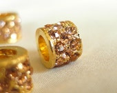 Golden Champagne Crystal Rhinestone, Gold Finish large hole Spacer Barrel Bead, 8mm long x 11mm diameter, hole measures 6mm, pkg 2 pieces