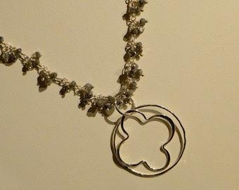 """20"""" Iolite cluster with quatrefoil circle pendant"""