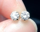 Brilliant white diamond earrings .26 carat total (3mm each) SI2 in 14 kt gold