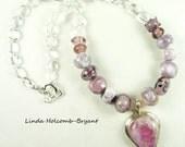 Necklace of Pink Black And White Lampwork Beads
