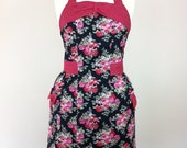 Retro apron with bow, red and pink floral on a black fabric, fully lined.
