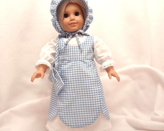 Four-piece outfit for 18 inch dolls.  Dress, Jumper, Pantaloons, and Bonnet.