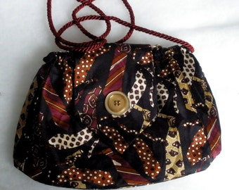 Tie Purse made from a tie decorated with ties