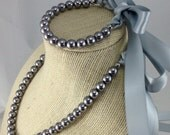 Grey strand necklace with ribbon closure