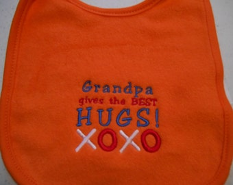 Grandpa Gives The Best Hugs Orange Baby Bib Embroidered Baby Shower Gift