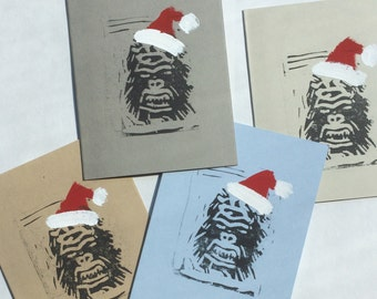 "Holiday card, ""Kringle Kong,"" handmade linocut with gouache added"