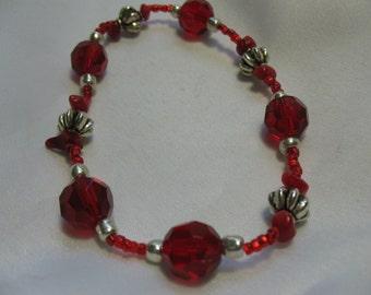 Red crystal bracelet.