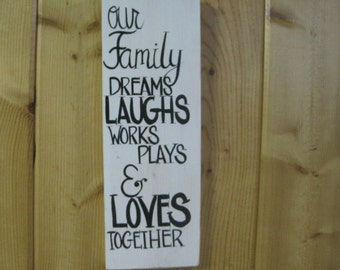 Our family dreams laughs works plays & loves together, family sign