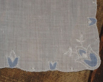 White hankie, blue tulip embroidery
