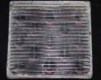 Salvaged glass raindrop prism tile