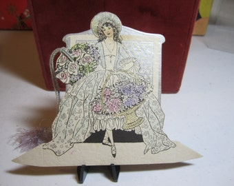 1920's unused art deco die cut silver gilded and hand colored Buzza place card Bride with removable flower bouquet bridge tally