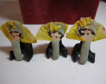1920s Art Deco Crepe Paper Flapper Girl Party favors bobbed hair flappers wearing cloche hats