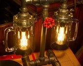 Table Lamp. Beer mugs, Plumbing pipe & fittings. With vintage style Edison bulbs.