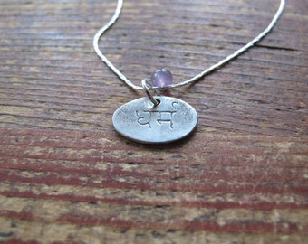 Dharma Sanksrit Fine Silver Charm necklace with Amethyst accent