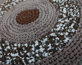 Brown, beige and white handmade circle rug