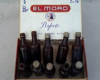 Lot of 10 Brown glass miniature liquor sample bottles in El Moro cigar box as found