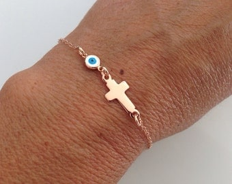 Rose gold vermeil cross bracelet with tiny evil eye