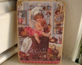 Vintage style cherub with chocolate, in kitchen, sugar, image on wooden tag to hang on door or dresser