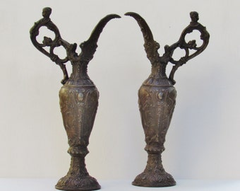 Antique metal ewers, late 1800's pair of Victorian faux bronze ewers, white metal ewers with female figures and cherubs