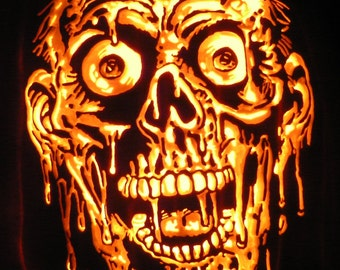 Tarman zombie hand-carved on a foam pumpkin for Halloween decorating.  This will last for years.  Great gift for your zombie fan.
