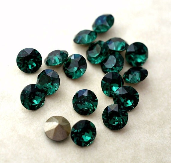 18 Emerald 34ss Swarovski Xirius - 63.9KB