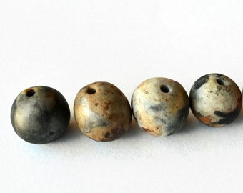 Earthy and organic ceramic beads made in South Africa, pitfired beads, Earth Butter Beads, African beads