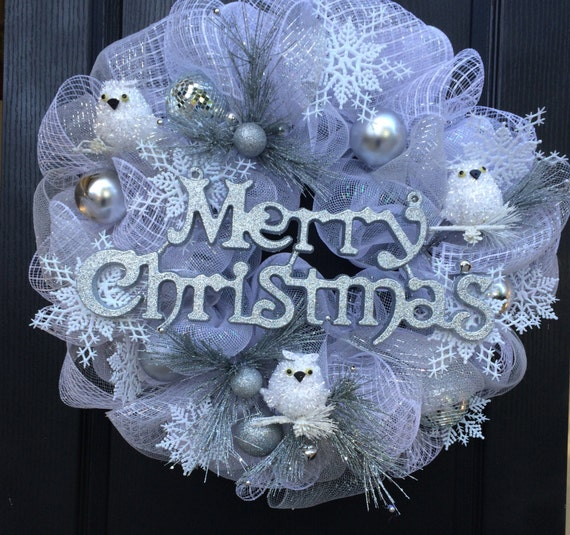 Christmas Wreath, with white owls, snowflakes, accented with Merry Christmas,deco mesh in white and silver shades.