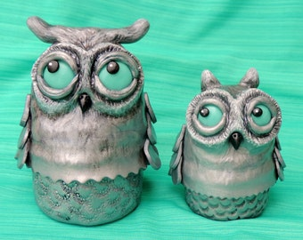 Horned Owls with glow in the dark eyes