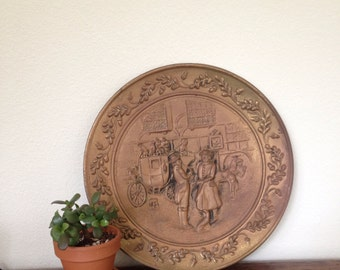 vintage mid century brass tray charger wall hanging, made in england, hollywood regency wall hanging
