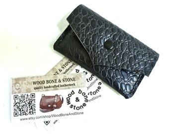 Embossed black leather business card case, credit card case.