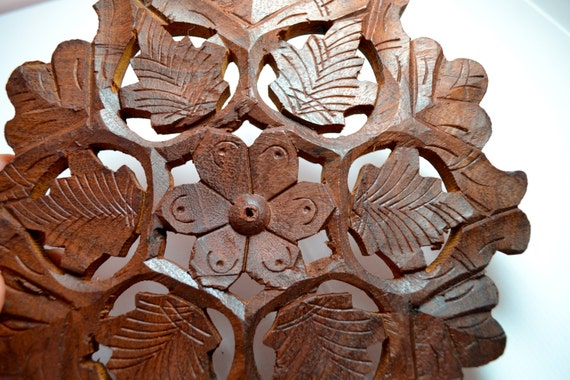 Vintage dark wood carved round trivet or incense by