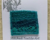 BROOCH embroidered textile brooch pin, textured seablues and turquoise fabrics with machine embroidery
