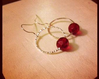 Hammered Silver hoops with ruby red faceted glass beads