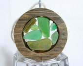 Small weathered cedar round, filled with various green and citron sea glass