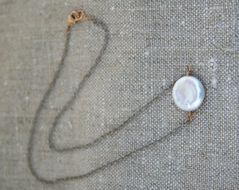 Simple white coin pearl on sterling silver chain with 14k gold filled clasp
